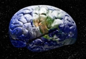 Brain on black background, with pattern of earth from space on its surface