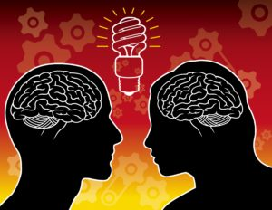 "SIlhouettes of a couple showing their brains and an ""idea"" lightbulb between them"