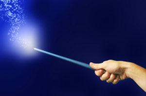 Photo of a hand waving a magic wand