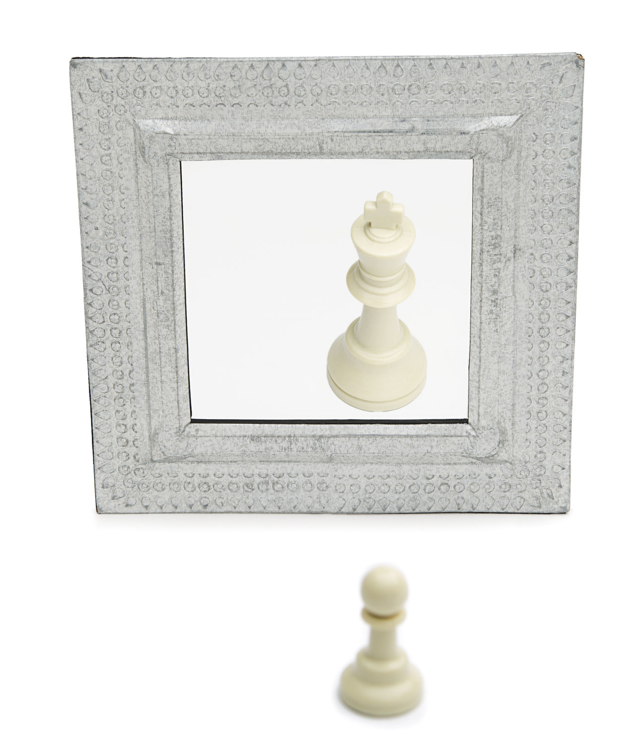 Chess pawn looking in mirror and seeing a king