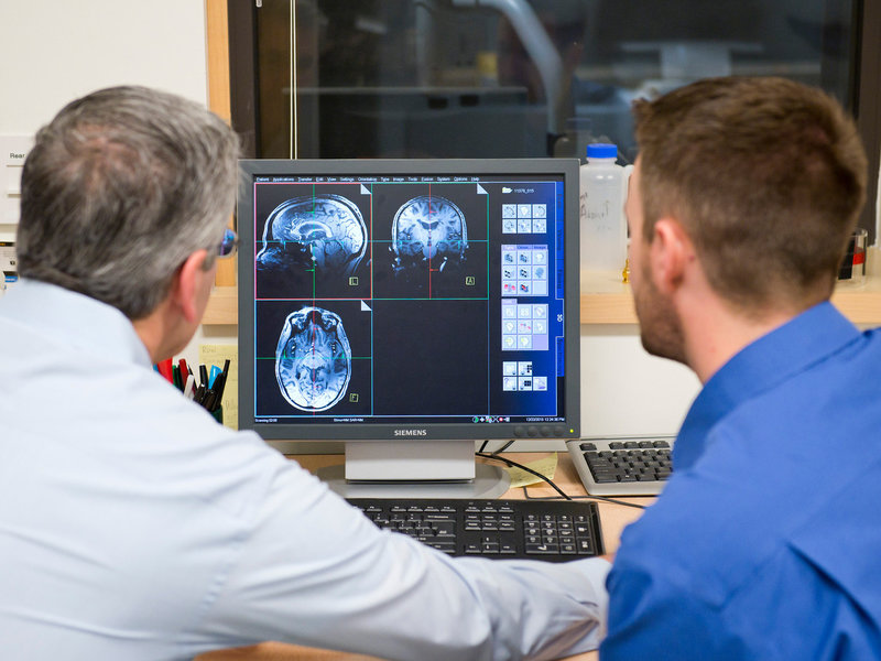Brain scientists at Oregon Health & Science University, look over an MRI as part of their research into whether poor sleep now contributes to Alzheimer's later.